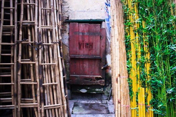 Hidden door on Bamboo Street in Hanoi