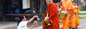 Photo of the Week: Monks Receiving Alms in Champasak, Laos